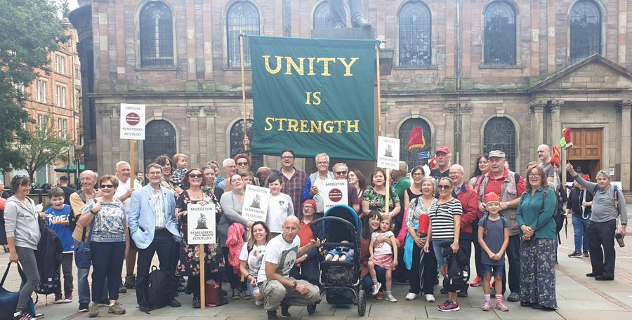 unity is strength banner at St Ann's Square