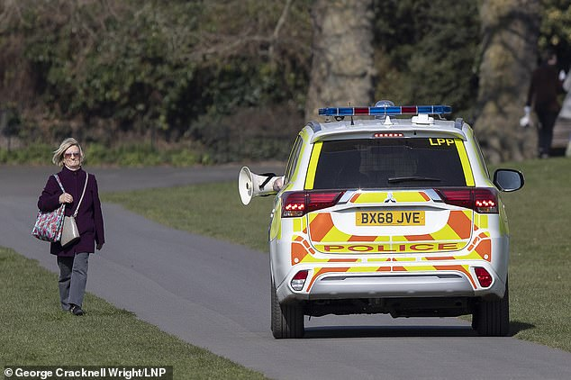 woman walking police car